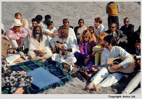 The Beatles playing guitar with Donovan, Mike Love on the Beach with Maharishi